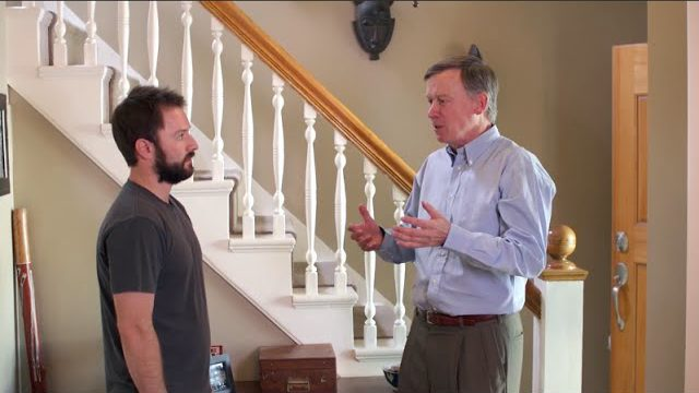 "Adam Cayton-Holland with Colorado Governor John Hickenlooper in ""Rocky Mountain Height"""